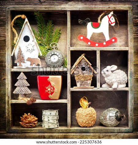 Christmas collage with Christmas decorations. Antique clocks, rocking horse and Christmas toys. Retro Style. - stock photo