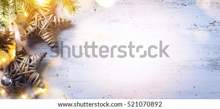 Christmas composition; Christmas decoration and fir tree branches, holidays light on white wooden background;  Flat lay, top view