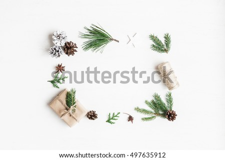 Christmas composition. Christmas gift, pine cones, fir tree branches. Top view, flat lay.