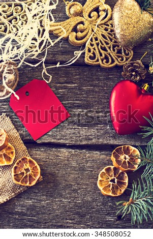 Christmas composition. Fir branches and Christmas decorations on a background of wooden boards
