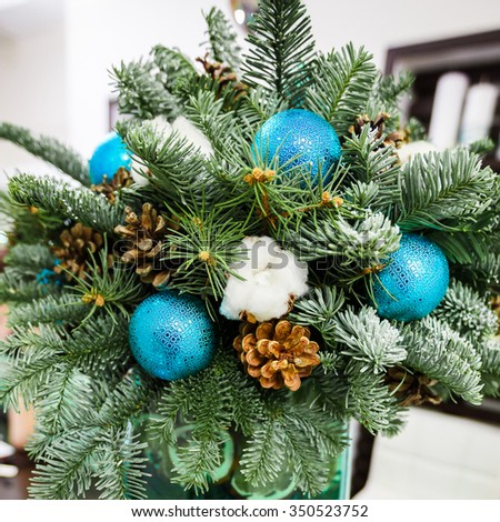 Christmas composition. fir-tree branches, pine cones and blue balls - stock photo