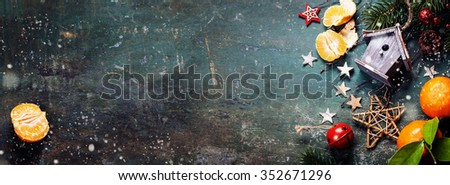 Christmas composition on dark vintage background - stock photo