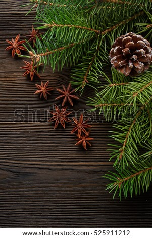 Christmas composition on wooden background with Christmas tree, pine cones and star anise. Christmas background, pine cones, fir branches. Flat lay, top view