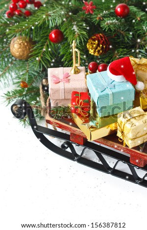 Christmas composition. Santa's sleigh with presents on a white. - stock photo