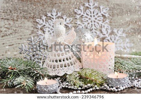 Christmas composition with angel and a candles - stock photo