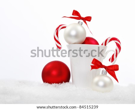 Christmas composition with candies and christmas decoration over white