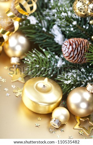 Christmas composition with candle and decorations