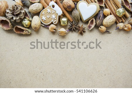 Christmas composition with cookies, candy, pine cones, nuts, coffee and seeds