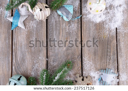 Christmas composition with fir tree, toys and snow on wooden background - stock photo