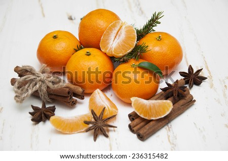 Christmas composition with fresh mandarin oranges, cinnamon, anise on old wooden background - stock photo