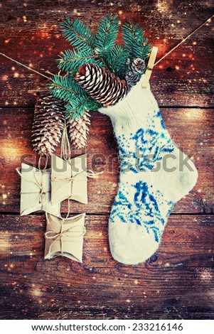 christmas composition with socks, present boxes fir and fir-cone on wooden background/ Christmas card with christmas rustic decorations
