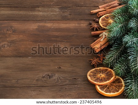 Christmas composition with spices  and branches on wood - stock photo