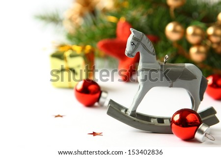 Christmas composition with wooden toy rocking horse - stock photo