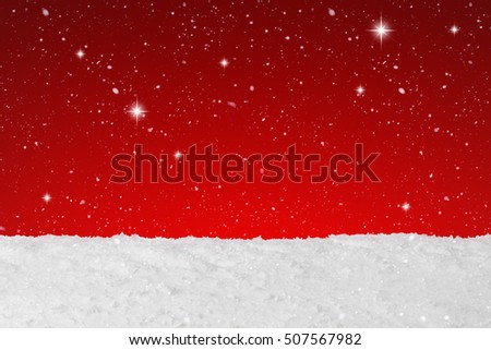 Christmas concept showing snow falling and stars on a background