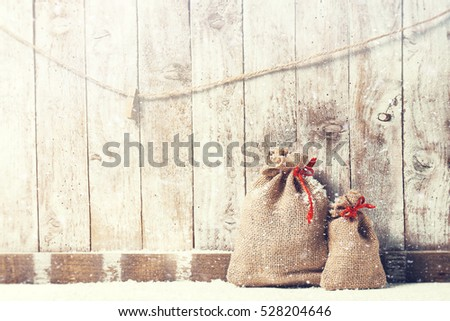 Christmas concept with various gifts on a wooden background. Christmas, home or winter concept