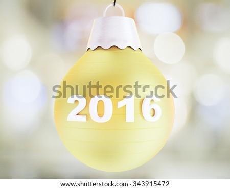 Christmas 2016 concept with yellow christmas tree ball - stock photo