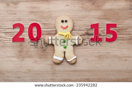 Christmas 2015 cookie with homemade christmas painted ginger-breads (gingerbread man) on the wooden background  - stock photo