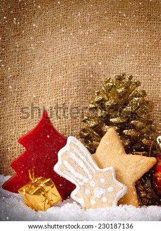 Christmas cookies and decoration isolated on brown background.