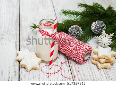 Christmas cookies and milk with decorations on a wooden table
