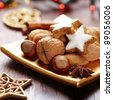 Christmas cookies and nuts on a plate - stock photo