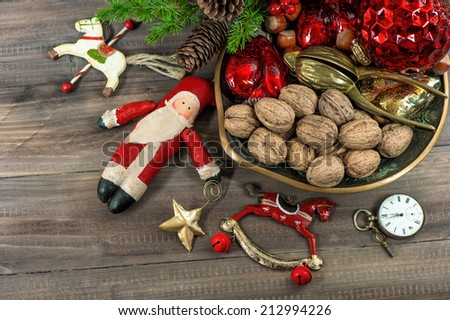 christmas cookies and walnuts with vintage decorations on wooden background - stock photo