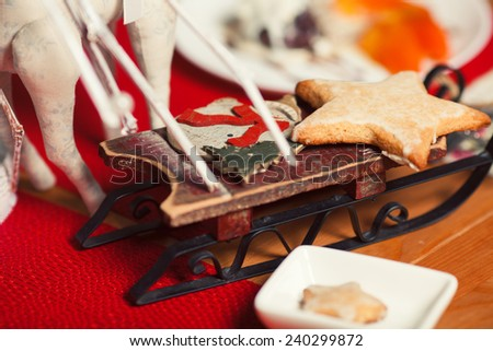 Christmas cookies concept. Creative snack set of cookies with arty handmade decoration in vintage cafe. Close up. Indoor shot - stock photo