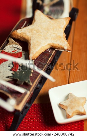 Christmas cookies concept. Creative snack set of cookies with arty handmade decoration in vintage cafe. Retro style. Close up. Indoor shot - stock photo