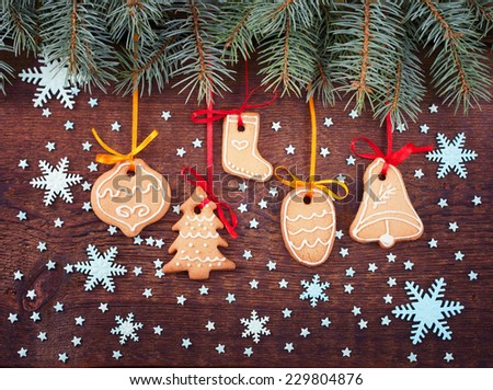 Christmas cookies handmade lies on wooden background. Gingerbread reindeer cookies and christmas decoration.  Christmas tree  - stock photo