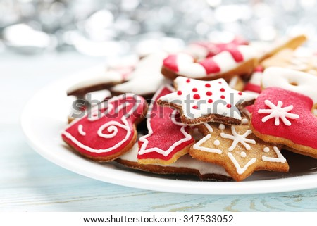 Christmas cookies in plate on a blue wooden table
