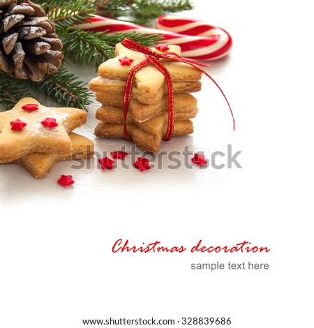 Christmas cookies in the shape of star with festive decoration - stock photo
