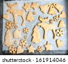Christmas cookies on a baking tray - stock photo