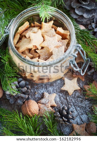Christmas Cookies Stars in the glass jar with Fir Tree, top view - stock photo