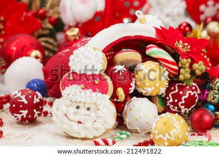 Christmas Cookies. Sweet Sugar Santa Hat cone, decorated with festive royal icing and Christmas cookies. Selective focus - stock photo