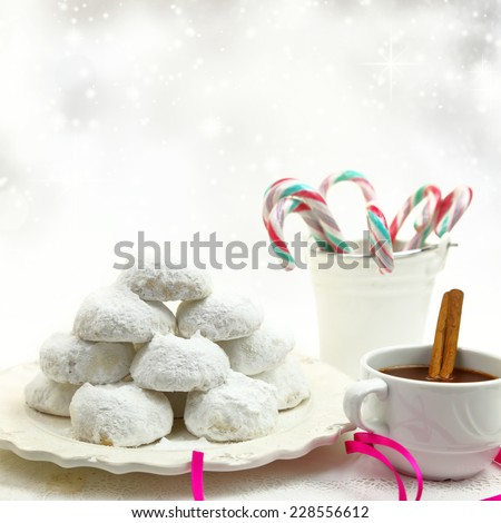 Christmas cookies with candies and coffee on white bokeh background - stock photo