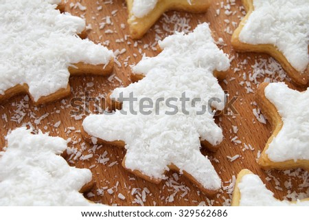 Christmas cookies with cream and coconut flakes on top - stock photo