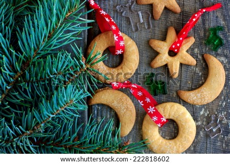 Christmas cookies with ginger decorated with red ribbon - stock photo
