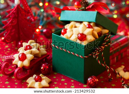 Christmas cookies with red candied cherries in the green gift box - stock photo