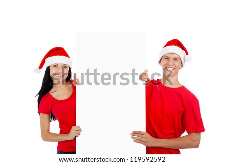 Christmas couple hold white board with empty copy space happy smile, concept of advertise new year season shopping sale, wear red hats and shirts, isolated over white background