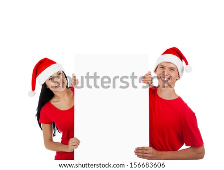 Christmas couple hold white board with empty copy space happy smile, concept of advertise new year season shopping sale, wear red hats and shirts, isolated over white background - stock photo