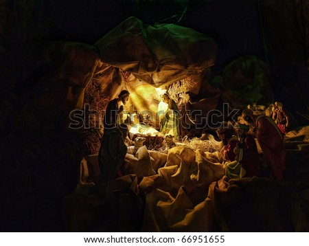 Christmas crib figures representing Holy Family, three wisemen and shepherds - stock photo