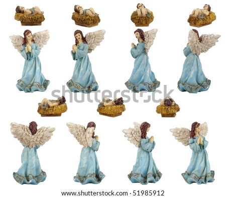 Christmas crib isolated on white statuettes representing Jesus and the Angel. - stock photo
