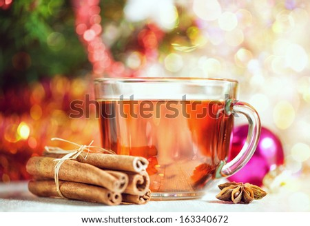 Christmas cup of tea and spices - stock photo