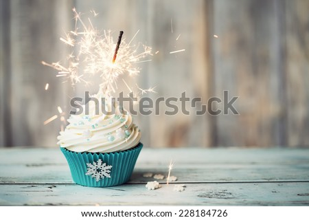 Christmas cupcake decorated with sparkler - stock photo