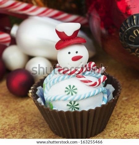Christmas cupcakes candy and decoration - stock photo