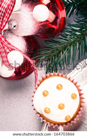 Christmas cupcakes, spruce branches and christmas bells - stock photo