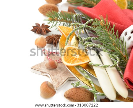 Christmas cutlery on a white background - stock photo