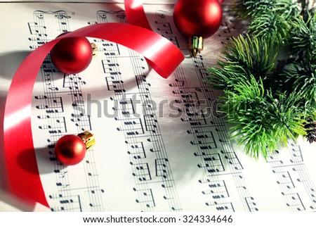 Christmas decor on music notes background - stock photo