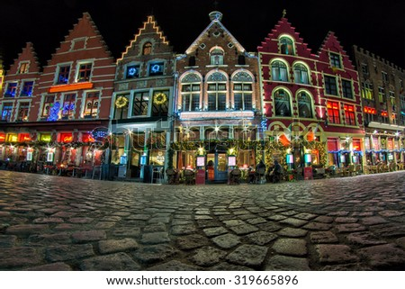 Christmas decorated and illuminated Old Markt square in the center of Bruges, Belgium - stock photo