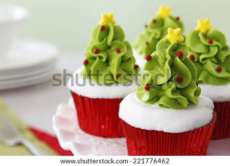 Christmas decorated cupcakes - stock photo