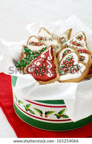Christmas decorated gingerbread cookes in a tin         - stock photo